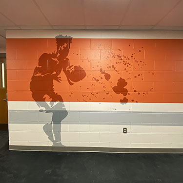 Abstract sports player mural